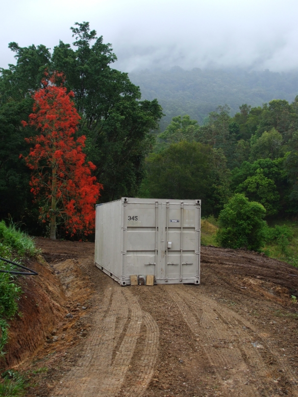 The shipping container arrives on the site. WE use it for storage, for yoga and for our books and art stuff.
